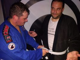 Tying a belt on your gi is a lot like tying a tie. Both of which I had to find an adult to help me do.